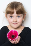 Flower in the hands of a young girl. Fresh flower in the hands of a young girl Stock Images