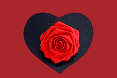 Paper flower & heart. A single paper rose on a black heart Stock Photography