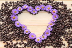 Flower heart. Heart made of flowers on the coffee bean Stock Images