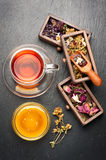 Flower herbal tea with honey and dried herbs and flowers. top view Royalty Free Stock Photo