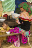 A flower hmong and her baby at Bac Ha Week end market Royalty Free Stock Image