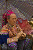 A flower Hmong women under an umbrella at Bac Ha Royalty Free Stock Photos