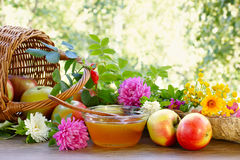 Flower honey, apples and garden flowers Stock Photo