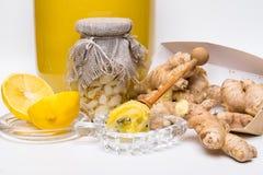 Honey, garlic, lemon and ginger - natural medicine, healthy food. Flower honey, garlic with koriander, lemon slices and raw ginger - natural medicine, healthy stock photo