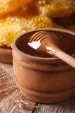 Flower honey in a wooden bowl with a stick close-up. vertical Royalty Free Stock Images