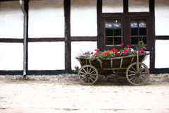 Flower horse cart at the old house Stock Photos