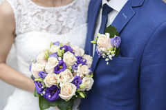 Flower on husband suit and beautiful wedding bouquet Stock Image