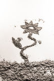 Flower illustration made of scattered pile of dust, ash, sand Stock Photos