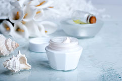 Flower and jar of moisturizing face cream for spa Royalty Free Stock Photography
