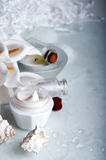 Flower and jar of moisturizing face cream for spa Royalty Free Stock Photo