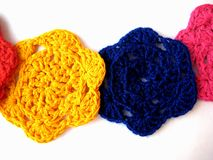 Flower is knitted yellow, blue, pink, Royalty Free Stock Photography