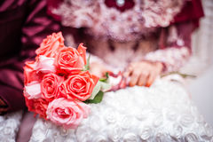 Flower on lap. View of a bouquet of flower on a lady's lap Stock Photos