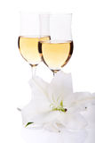 Flower of lilly and two champagne glasses Royalty Free Stock Image