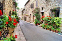 Medieval Assisi. Flower lined medieval street in Assisi, Italy stock photos