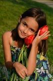 Flower loving girl Stock Photos