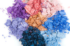 Flower made of crumbled makeup eyeshadows. Closeup Royalty Free Stock Image