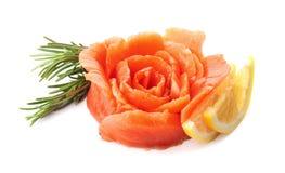 Flower made of fresh sliced salmon fillet. On white background royalty free stock photo