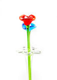 Flower made of glass in red and blue color in vase on white back Stock Images