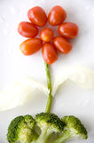 Flower made from veggie. Flower shape made from tomato and veggie Royalty Free Stock Photos