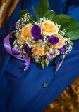 Flowers in a man`s jacket. stock photos