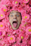Flower man with tongue stuck out Royalty Free Stock Photos