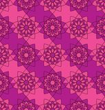Flower Mandala symmetry seamless pattern purple pink colors. This illustration is  design and drawing flower mandala symmetry with purple and pink colors with Stock Photography
