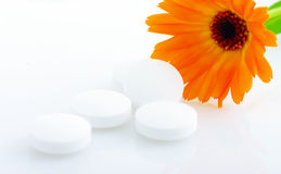 Flower marigold medical with pills Stock Images