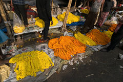 Flower market of Kolkata, West Bengal, India. KOLKATA, WEST BENGAL / INDIA - FEBRUARY 13TH : Buying and selling of flowers in crowded and colorful Mallik Ghat or Royalty Free Stock Images