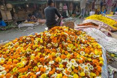 Flower market of Kolkata, West Bengal, India. KOLKATA, WEST BENGAL / INDIA - FEBRUARY 13TH, 2016 : Buying and selling of flowers in crowded and colorful Mallik Royalty Free Stock Photos