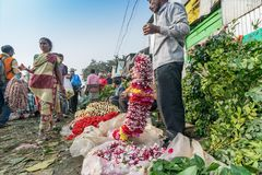 Flower market of Kolkata, West Bengal, India. KOLKATA, WEST BENGAL / INDIA - FEBRUARY 13TH, 2016 : Buying and selling of flowers in crowded and colorful Mallik Royalty Free Stock Photo