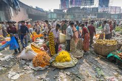 Flower market of Kolkata, West Bengal, India. KOLKATA, WEST BENGAL / INDIA - FEBRUARY 13TH, 2016 : Buying and selling of flowers in crowded and colorful Mallik Stock Photo
