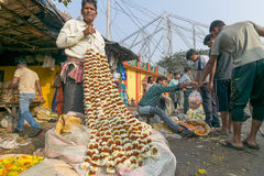 Flower market of Kolkata, West Bengal, India. KOLKATA, WEST BENGAL / INDIA - FEBRUARY 13TH, 2016 : Buying and selling of flowers in crowded and colorful Mallik Stock Photography