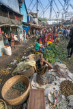 Flower market of Kolkata, West Bengal, India. KOLKATA, WEST BENGAL / INDIA - FEBRUARY 13TH, 2016 : Buying and selling of flowers in crowded and colorful Mallik Royalty Free Stock Photography