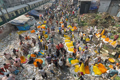 Flower market of Kolkata, West Bengal, India. KOLKATA, WEST BENGAL / INDIA - FEBRUARY 13TH : Over view of Busy ,crowded and colorful Mallik Ghat or Jagannath Royalty Free Stock Photography