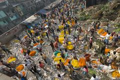 Flower market of Kolkata, West Bengal, India. KOLKATA, WEST BENGAL / INDIA - FEBRUARY 13TH, 2016 : Top view of Busy ,crowded and colorful Mallik Ghat or Stock Photo