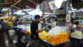 Flower market Pak Khlong Talat. Bangkok, Thailand February 5, 2017: View of Bangkok Flower Market Pak Khlong Talat in Bangkok. People walk around the area. It is stock video