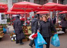 Advent Market in Zagreb feature. Flower market stalls part of the Advent Market celebration. Ladies purchasing flowers for the holidays stock photos