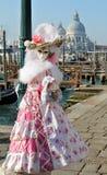 Flower mask at gondola's docks Royalty Free Stock Photo