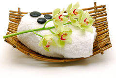 Flower and  massage stone on towel isolated Royalty Free Stock Photo