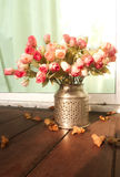 Flower in metal. Pot on wood Royalty Free Stock Photography