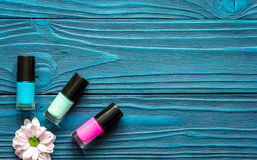 Flower, nail polish and manicure set on dark wooden background. Top view stock photography