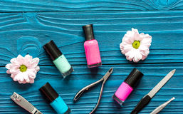 Flower, nail polish and manicure set on dark wooden background Stock Photography