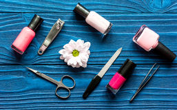 Flower, nail polish and manicure set on dark wooden background Royalty Free Stock Photography