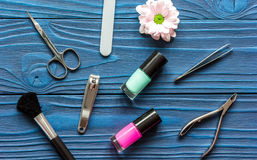 Flower, nail polish and manicure set on dark wooden background Royalty Free Stock Photos
