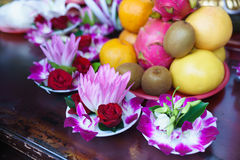 Flower Offerings At Lungshan Temple. Plates of lotus and orchid flowers create a colorful background pattern while waiting to be distributed as offerings at the Stock Photo