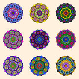 Flower ornaments. Nine round flower ornaments in different colors Royalty Free Stock Photos