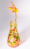 Flower in painted bottle Stock Photo