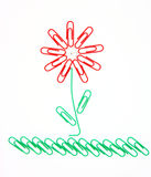 Flower from paper clips. Beautiful flower on a grass from office paper clips for a paper Royalty Free Stock Images