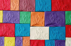 Flower  pattern. Colorfull pattern of flowers stamped on plasticine plates Stock Photos