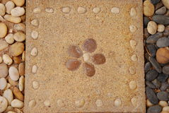Flower pattern on brick. This brick in the garden.and it has a flower pattern on it Royalty Free Stock Photos